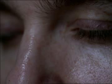 extreme close up eyes of male drug addict with eyelids lowering + eyeballs rolling back into head - dålig vana bildbanksvideor och videomaterial från bakom kulisserna