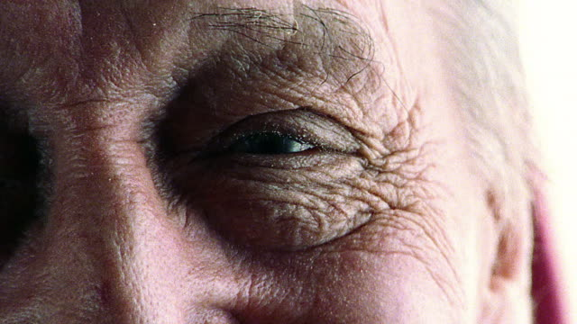 extreme close up eyes of senior man - eye stock videos & royalty-free footage