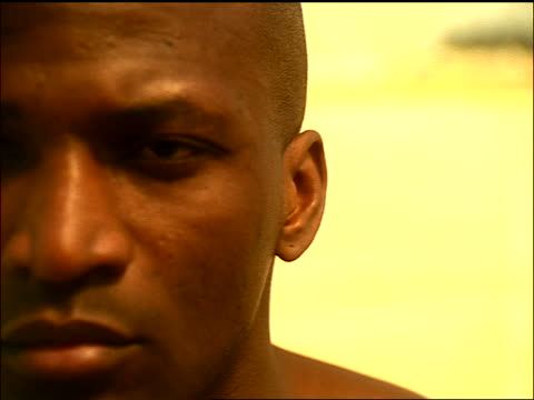 sepia extreme close up face of bald black man looking up at sky - getönt stock-videos und b-roll-filmmaterial