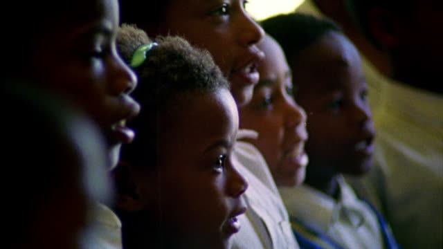 extreme close up faces of black children standing and speaking in unison / south africa - schoolgirl stock videos and b-roll footage