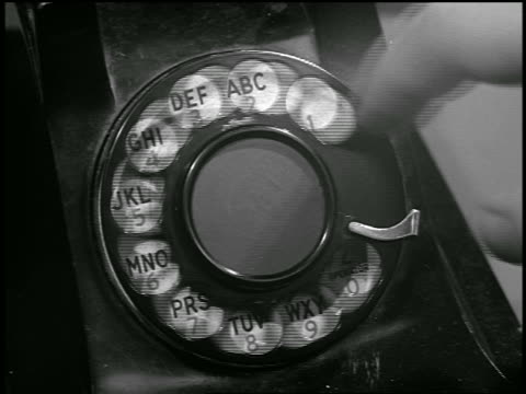 b/w extreme close up finger dialing on rotary telephone - telephone dial stock videos & royalty-free footage