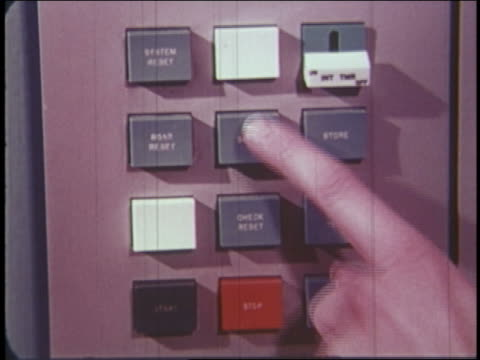 1965 extreme close up finger pushing button on computer - schieben stock-videos und b-roll-filmmaterial