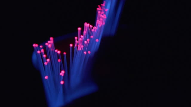 extreme close up fingers playing with fiber optic cables - fibre optic stock videos & royalty-free footage