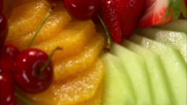 extreme close up fruit salad arranged on a plate / auckland, new zealand - fruit salad stock videos & royalty-free footage