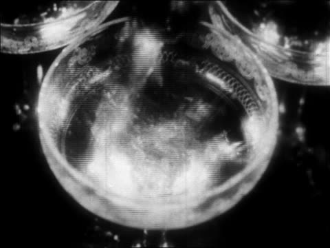 vidéos et rushes de b/w 1928 extreme close up glass filling up with champagne / newsreel - stéréotype de la classe supérieure