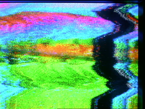 vidéos et rushes de extreme close up greenish static on television screen with various images in static - 1990 1999