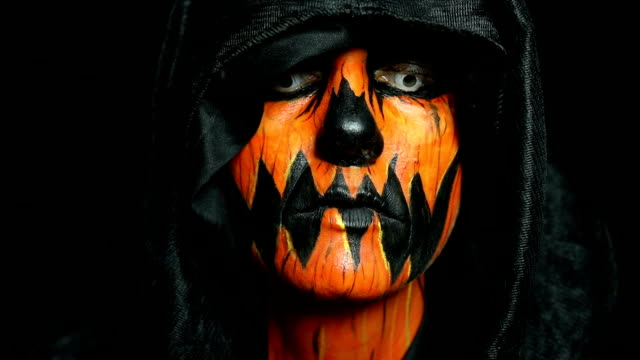 extreme close up halloween pumpkin face paint - halloween stock videos & royalty-free footage