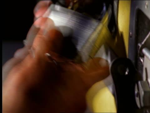 extreme close up hand turning + locking padlock on door