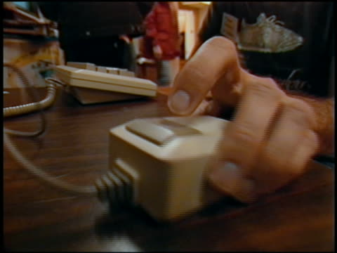 1984 extreme close up hand using early computer mouse / keyboard in background / marin, california - desktop pc stock-videos und b-roll-filmmaterial