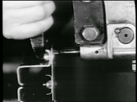 b/w 1944 extreme close up hands of woman riveting / world war ii / industrial - 1944 stock videos and b-roll footage