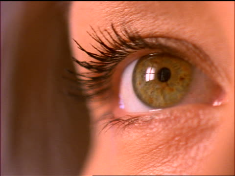 extreme close up hazel eye of woman looking up - hazel eyes stock videos & royalty-free footage