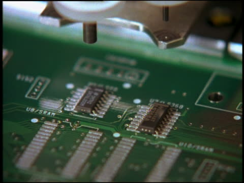 extreme close up machine installing computer chips on circuit board - computer chip stock videos & royalty-free footage