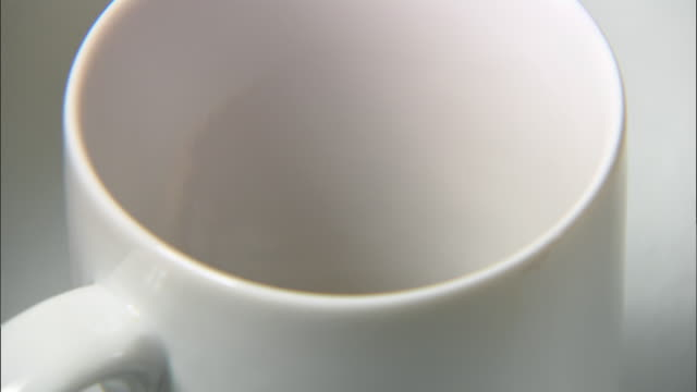 Extreme close up making instant coffee in mug