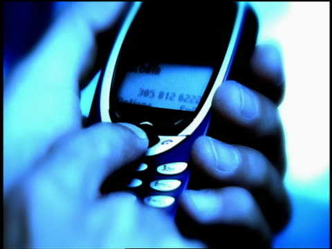 "blue extreme close up male hands holding cellular phone + calling ""home"" - 2001 stock videos and b-roll footage"
