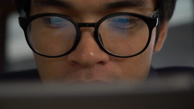 Extreme close up man face eyes glasses