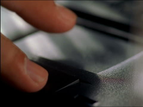 vídeos de stock, filmes e b-roll de extreme close up man's fingers using touchpad on laptop computer - touchpad