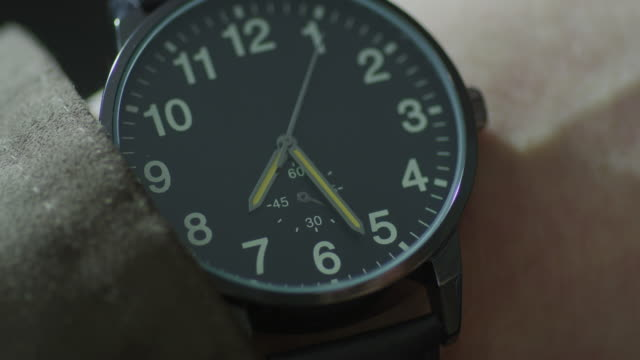 extreme close up, man's wrist watch with second hand and black face; watch reads 7:24. - elkhorn nebraska stock videos & royalty-free footage