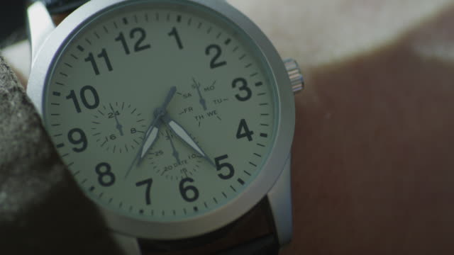 extreme close up, man's wrist watch with second hand and white face; watch reads 7:25. - elkhorn nebraska stock videos & royalty-free footage