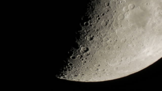 extreme close up moon surface time lapse passing through the night sky - half moon stock videos & royalty-free footage