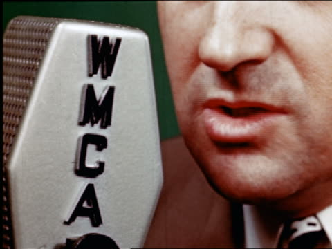 1945 extreme close up mouth of man speaking into wmca radio microphone / industrial - microphone stock videos & royalty-free footage