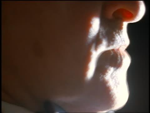 vídeos de stock, filmes e b-roll de profile extreme close up mouth of senior man talking + contemplating - falando