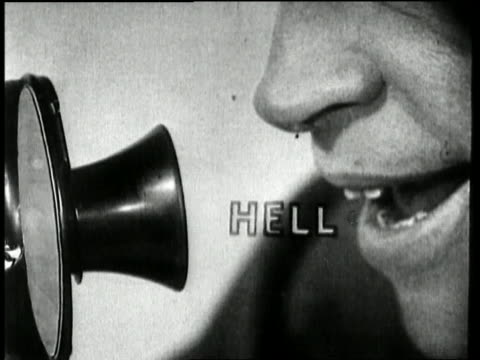 """stockvideo's en b-roll-footage met 1928 extreme close up mouth speaking the animated words """"hello"""" into a telephone mouthpiece - menselijke neus"""