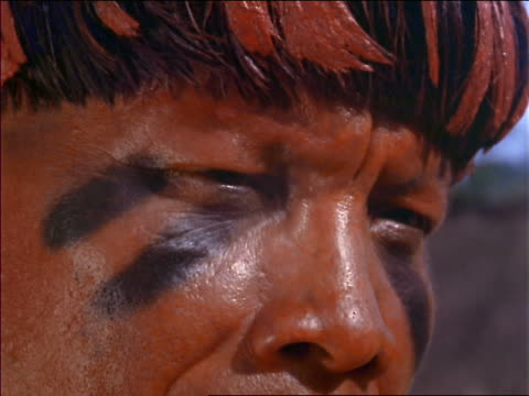 extreme close up native man looking offscreen / amazonas, brazil - amazonas state brazil stock videos and b-roll footage