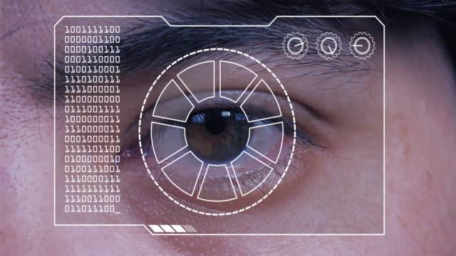 extreme close up of a man's eye, with a hud scanning graphic overlay. - eyeball stock videos and b-roll footage