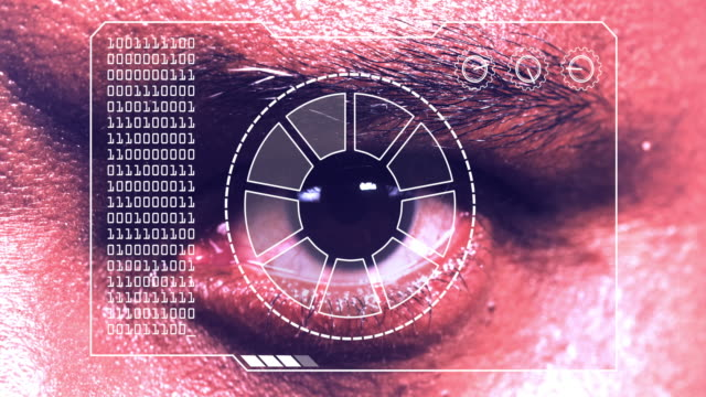 Extreme close up of a man's eye, with a hud scanning graphic overlay.