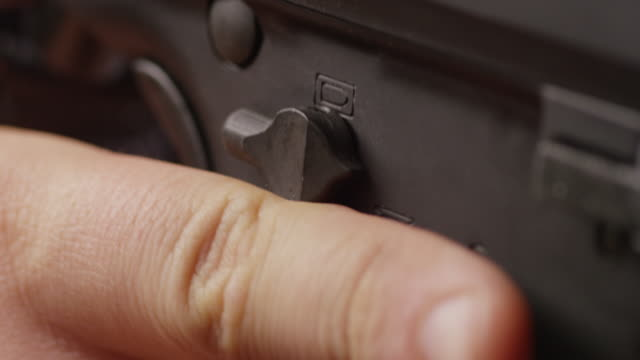 extreme close up of a submachine gun safety switch is turned on and off. - submachine gun stock videos & royalty-free footage