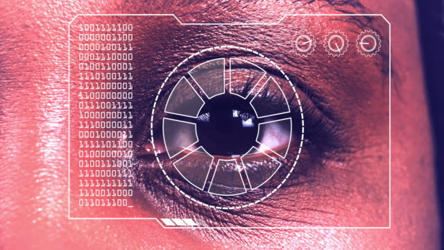 Extreme close up of a woman's eye, with a hud scanning graphic overlay.