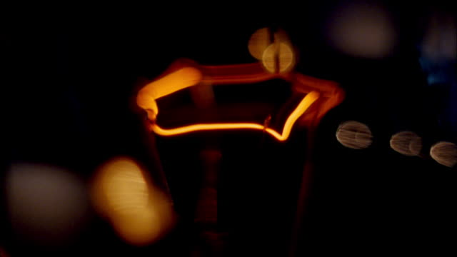 Extreme close up of flashing light filament