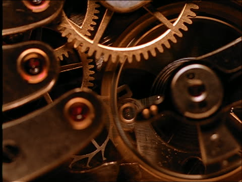 extreme close up of gears of watch - instrument of time stock videos & royalty-free footage