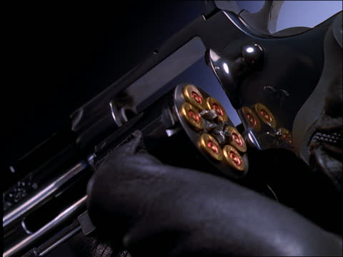 extreme close up of gloved hand loading full chamber on pistol - handgun stock videos & royalty-free footage