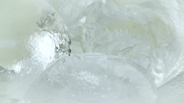 extreme close up of ice cubes - ice stock videos & royalty-free footage