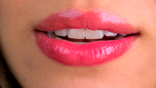 stockvideo's en b-roll-footage met extreme close up of licking lips and smiling - menselijke lippen