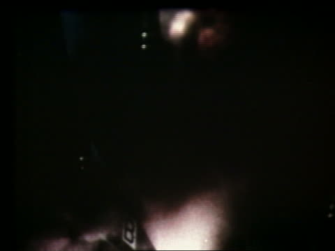 extreme close up of rockets igniting + blasting off - 1969年点の映像素材/bロール