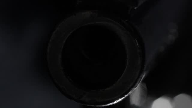 extreme close up of the barrel of a smith and wesson 44 magnum revolver track into shot - pistol stock videos & royalty-free footage