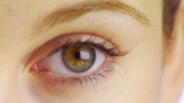 extreme close up of woman's eye - blinking stock videos & royalty-free footage