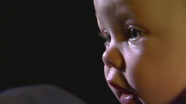 extreme close up on an infants face - människonäsa bildbanksvideor och videomaterial från bakom kulisserna