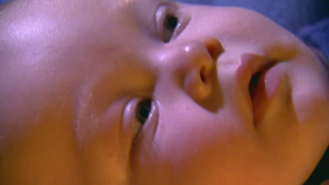 vídeos de stock, filmes e b-roll de extreme close up on baby boys face - veja outros clipes desta filmagem 1114