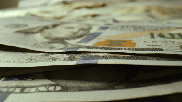 extreme close up on one hundred dollar bills - stacking stock videos & royalty-free footage