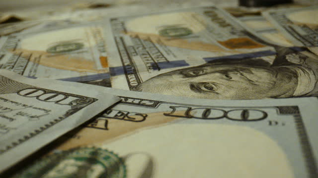 extreme close up on one hundred dollar bills - american one hundred dollar bill stock videos & royalty-free footage