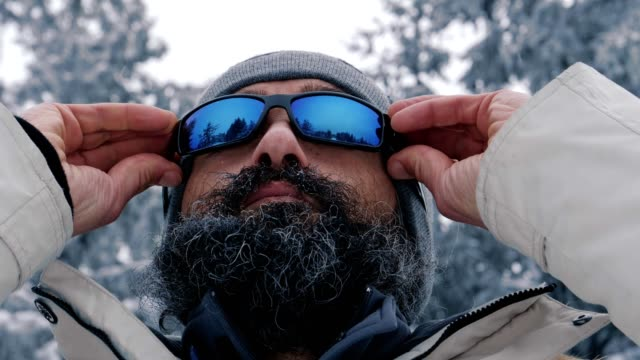 extreme close up, one middle-aged man enjoying the winter mountain, portrait, winter sport, travel, exploration, adventure, tourism, mountain climbing, determination, athlete, ladder of success, outdoors - ladder of success stock videos & royalty-free footage