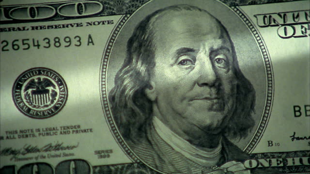 extreme close up pan benjamin franklin portrait on $100 bill - benjamin franklin stock videos & royalty-free footage