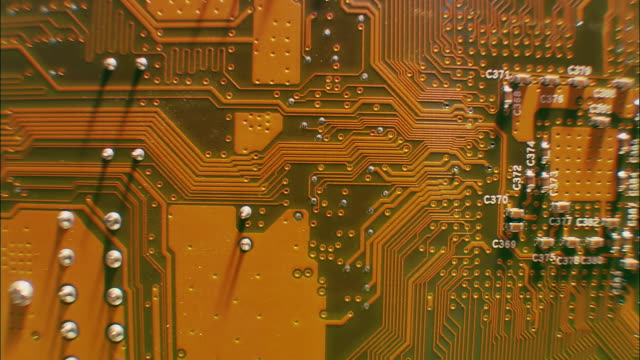 extreme close up pan circuit board - circuit board stock videos & royalty-free footage
