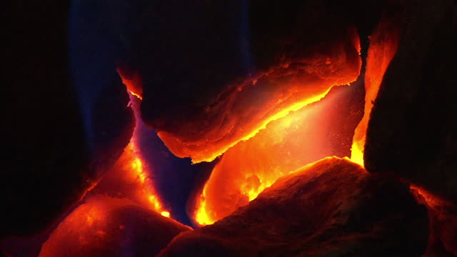 Extreme Close Up pan-left - Embers glow and burn. / Sweden