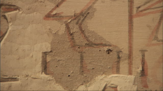 extreme close up, pan-right - hieroglyphics are carved into a wall / egypt - エジプト点の映像素材/bロール