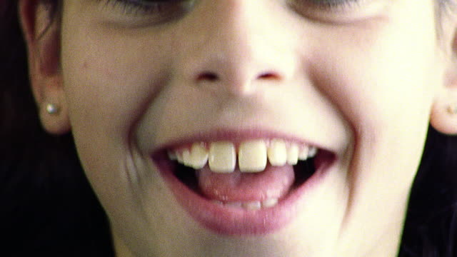extreme close up portrait girl looking into camera smiling + laughing - mouth open stock videos and b-roll footage