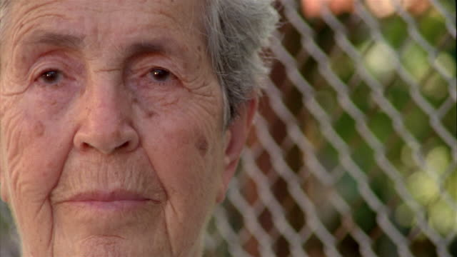 extreme close up portrait of elderly woman looking at cam - kelly mason videos stock videos & royalty-free footage